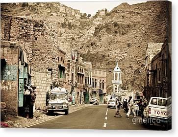 Passing Through A Village Canvas Print by Charuhas Images