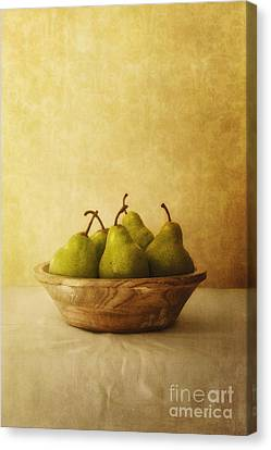 Pears In A Wooden Bowl Canvas Print by Priska Wettstein