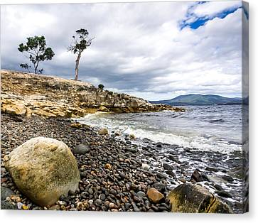 Pebbled Beach Under Dramatic Skies Number One Canvas Print by Kaleidoscopik Photography