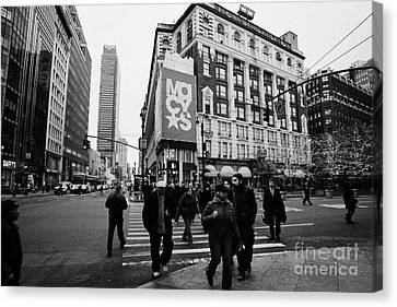 Pedestrians Cross Crosswalk Crossing Of 6th Avenue Broadway And 34th Street At Macys New York Usa Canvas Print by Joe Fox
