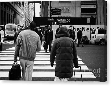 Pedestrians Crossing Crosswalk Carrying Luggage On Seventh 7th Ave Avenue Canvas Print by Joe Fox