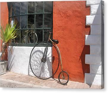 Penny-farthing In Front Of Bike Shop Canvas Print by Susan Savad