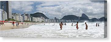 People Enjoying On Copacabana Beach Canvas Print by Panoramic Images