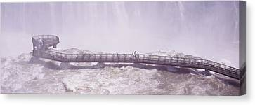 People On Cat Walks At Floodwaters Canvas Print by Panoramic Images