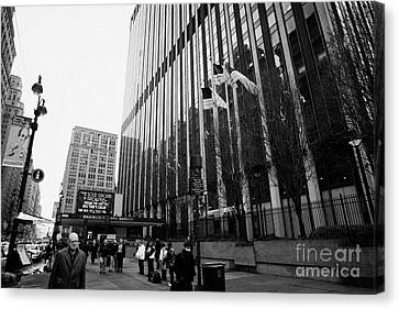 people on the sidewalk outside madison square garden with US flags flying new york city Canvas Print by Joe Fox