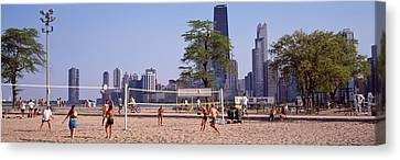 People Playing Beach Volleyball Canvas Print by Panoramic Images