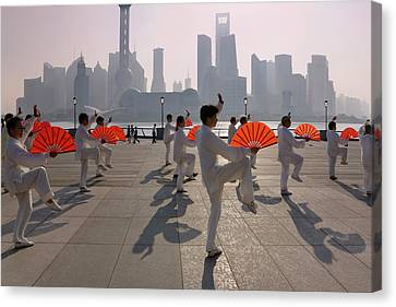 People Practicing Taiji With Red Fans Canvas Print by Keren Su