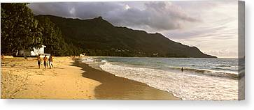 People Walking Along The Beau Vallon Canvas Print by Panoramic Images