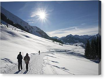 People Walking In Beautiful Sunny Winter Landscape In The Alps With Lots Of Snow Canvas Print by Matthias Hauser