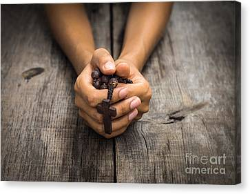 Person Praying Canvas Print by Aged Pixel