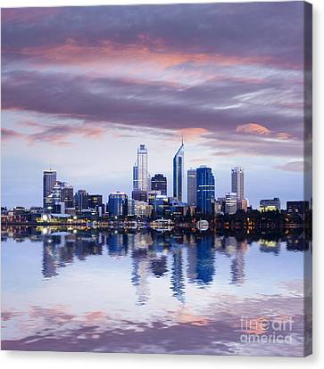 Perth Skyline Reflected In The Swan River Canvas Print by Colin and Linda McKie