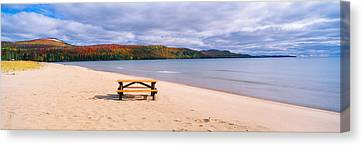 Picnic Table On Beach At Keweenaw Bay Canvas Print by Panoramic Images