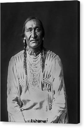 Piegan Indian Man Circa 1910 Canvas Print by Aged Pixel