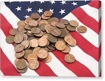 Pile Of Pennies On American Flag Canvas Print by Keith Webber Jr
