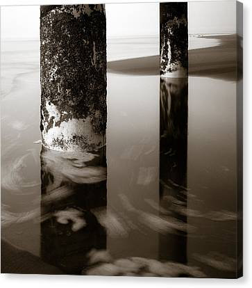 Pillars And Swirls Canvas Print by Dave Bowman