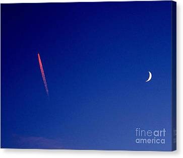 Pink Con Trail And Moon Canvas Print by Donnie Freeman