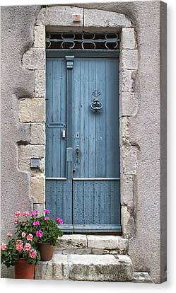 Pink Flowers And A Blue Door Canvas Print by Georgia Fowler