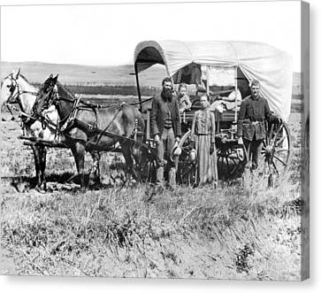 Pioneer Family And Wagon Canvas Print by Underwood Archives