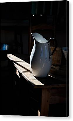 Pitcher On Table Canvas Print by Ron Weathers