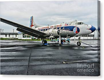 Plane On The Tarmac Canvas Print by Paul Ward