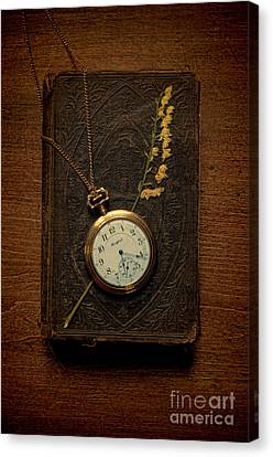 Pocketwatch On Old Book Canvas Print by Jill Battaglia