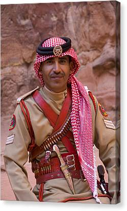 Policeman In Petra Jordan Canvas Print by David Smith
