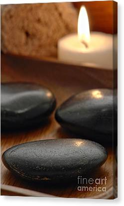 Polished Stones In A Spa Canvas Print by Olivier Le Queinec