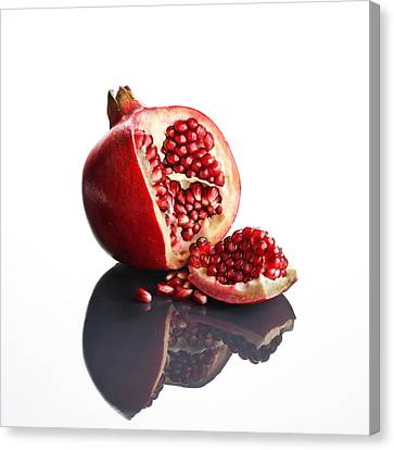 Pomegranate Opened Up On Reflective Surface Canvas Print by Johan Swanepoel