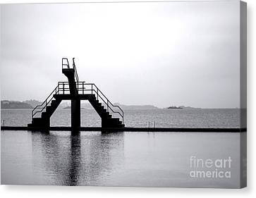 Pool By The Sea Canvas Print by Olivier Le Queinec
