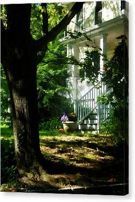 Porch With Pot Of Chrysanthemums Canvas Print by Susan Savad