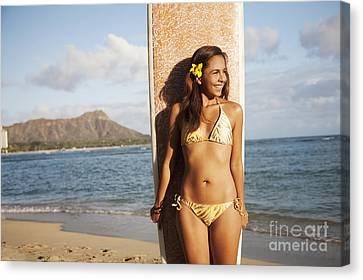Portrait Of A Woman On A Beach In A Bikini Holding A Surfboard_ Waikiki, Oahu, Hawaii, United States Of America Canvas Print by Brandon Tabiolo