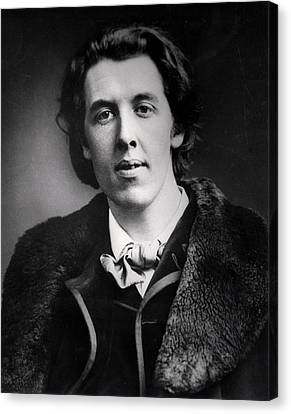 Portrait Of Oscar Wilde 1854-1900 Wearing An Overcoat With A Fur Collar Bought For His Trip Canvas Print by English Photographer