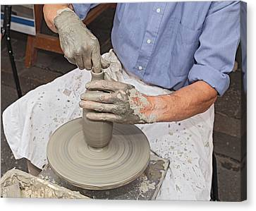 Potter Shaping Clay On A Potter's Wheel  Canvas Print by Ermess Images