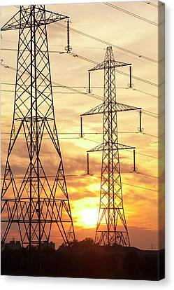 Power Lines And Pylons At Sunset Canvas Print by Ashley Cooper