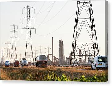 Power Lines To A Petrochemical Plant Canvas Print by Ashley Cooper