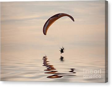Powered Paraglider Canvas Print by John Edwards