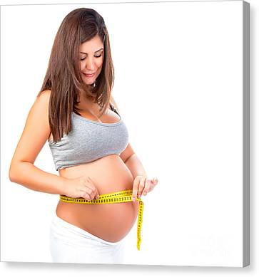 Pregnant Woman Measuring Belly Canvas Print by Anna Om