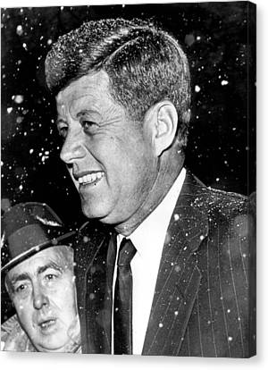 President John F. Kennedy In Snow Canvas Print by Retro Images Archive
