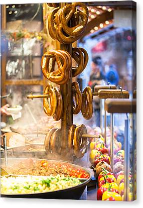 Pretzels And Food At German Christmas Market Canvas Print by Susan Schmitz