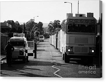 Psni Landrover And Watercannon In Wait In Preparation On Crumlin Road At Ardoyne Shops Belfast 12th  Canvas Print by Joe Fox