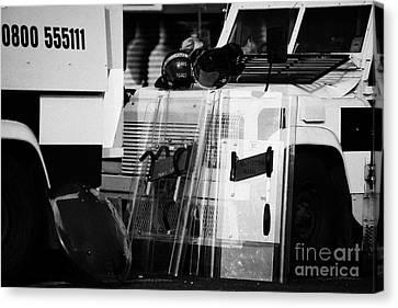 Psni Protective Riot Gear At Landrovers On Crumlin Road At Ardoyne Shops Belfast 12th July Canvas Print by Joe Fox