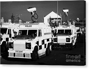 Psni Surveillance Landrovers With Cameras On Crumlin Road At Ardoyne Shops Belfast 12th July Canvas Print by Joe Fox