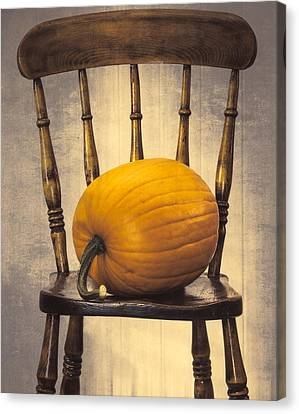 Pumpkin On Chair Canvas Print by Amanda And Christopher Elwell