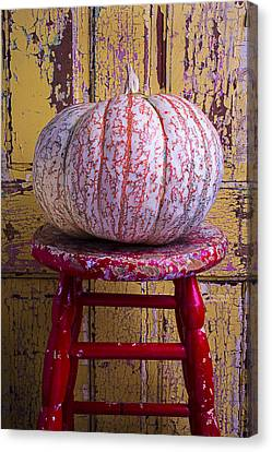 Pumpkin Sitting On Red Stool Canvas Print by Garry Gay