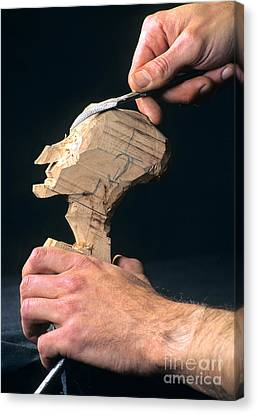Puppet Being Carved From Wood Canvas Print by Bernard Jaubert