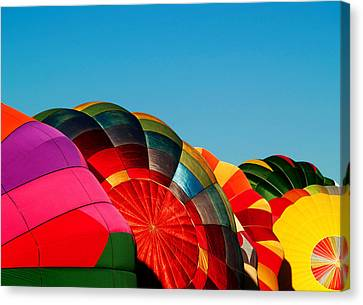 Racing Balloons Canvas Print by Bill Gallagher
