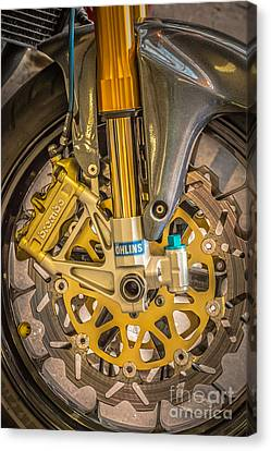 Racing Bike Wheel With Brembo Brakes And Ohlins Shock Absorbers Canvas Print by Ian Monk