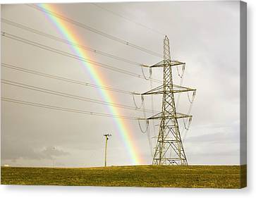 Rainbow Over Electricity Pylons Canvas Print by Ashley Cooper
