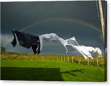 Rainbow, Stormy Sky And Clothes Line Canvas Print by Panoramic Images