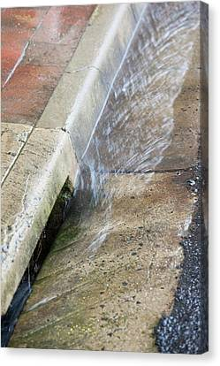 Rainfall In Gutter Canvas Print by Ashley Cooper